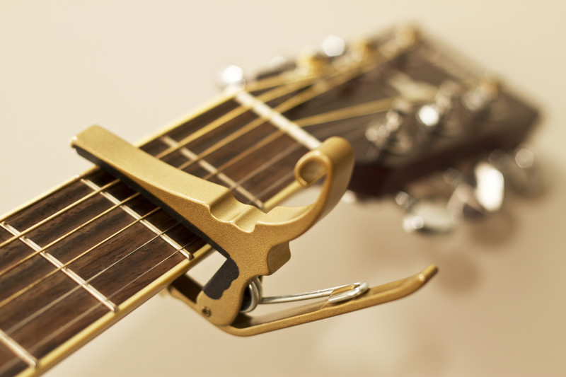Guitar Fretboard with Gold Capo